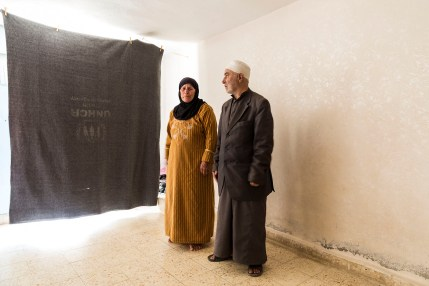 Nasser and Hiba in their new temporary home in Azraq – they didn't want to leave Syria but their children convinced them otherwise when a bombing attack destroyed their home and killed their neighbours. They now live in a basement room with their children's families.