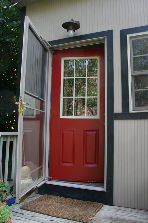 "Red doors might be cliche, but we've always wanted one.  The ""right"" red is tough and I got this one on the first try: Behr ""Heirloom Red""."