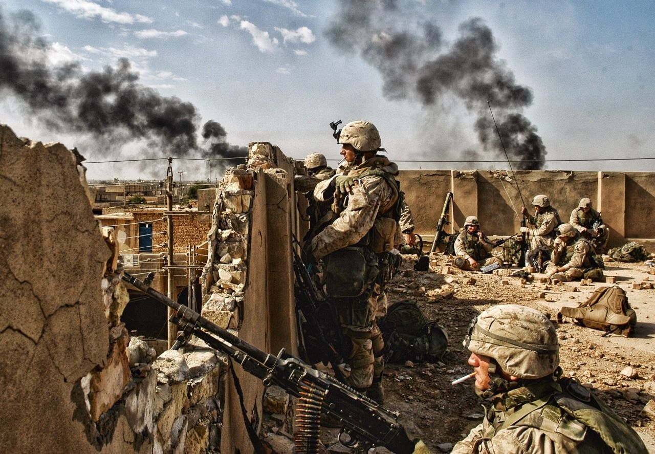 Soldiers stand guard on bombed out rooftop during Battle of Fallujah