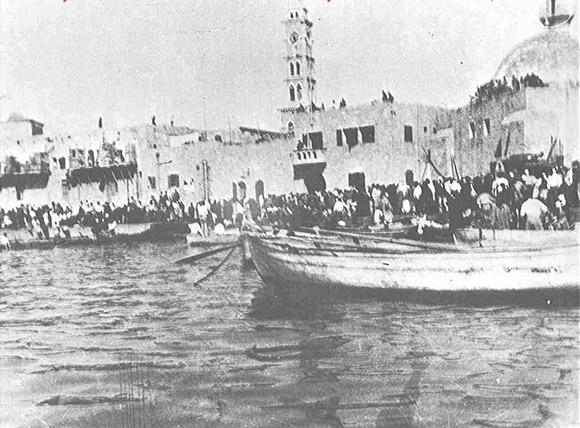Palestinians driven into the sea at Jaffa Harbor, late April 1948. With the land routes cut off by the Haganah, tens of thousands of the citizens of Jaffa and neighboring villages fled by boat: south to Gaza and Egypt, and north to Lebanon.