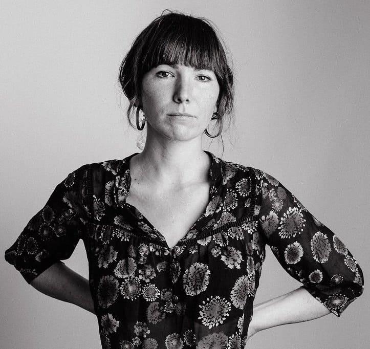 Anna Tivel, standing arms akimbo