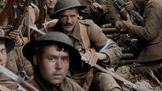 Colorized film footage of WWI men resting behind the lines from the movie They Shall Not Grow Old. Credit: Warner Bros. Entertainment