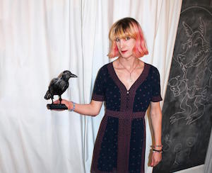 Author Charlie Jane Anders with a fake raven in her hand