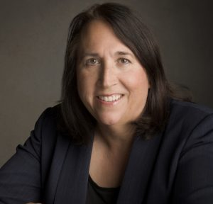 Portrait photo of Margaret Engel smiling