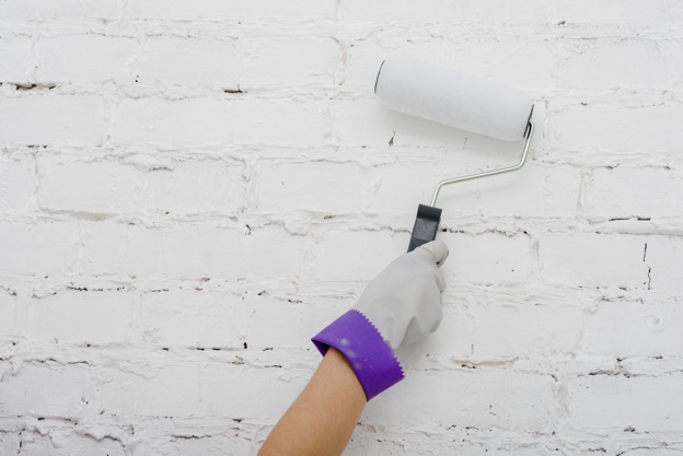 crop hand painting wall 23 2147758683 - Wallpaper Tips: How to Choose the Right Wallpaper for Your Interiors