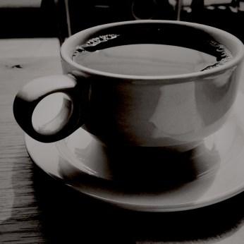 black and white photo of a coffee mug