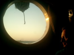 david-j-rodger-gazing-out-porthole-onto-the-river-nile