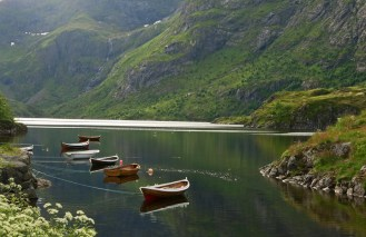 Rowing boats reflected on Fjord - Midnight Sun - Lofoten Islands - Norway