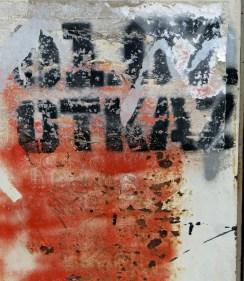 street art graffiti Mostar Bosnia clenched red fist
