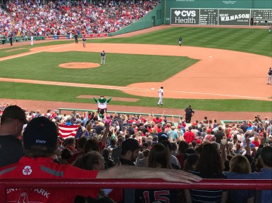 Fans at Fenway Park celebrated in the 8th inning as Wally the Green Monster leads a cheer