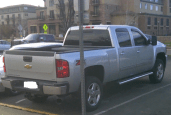 "A pic of a silver, four-door, automatic pickup truck.  Whited out license plate with ""Paint"" program"