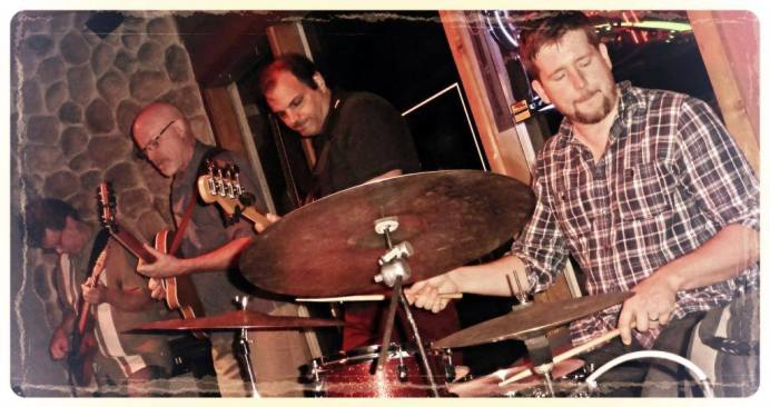 David Martin/Mike Doolin-guitar, Chris Bates-bass, Pete Hennig-drums