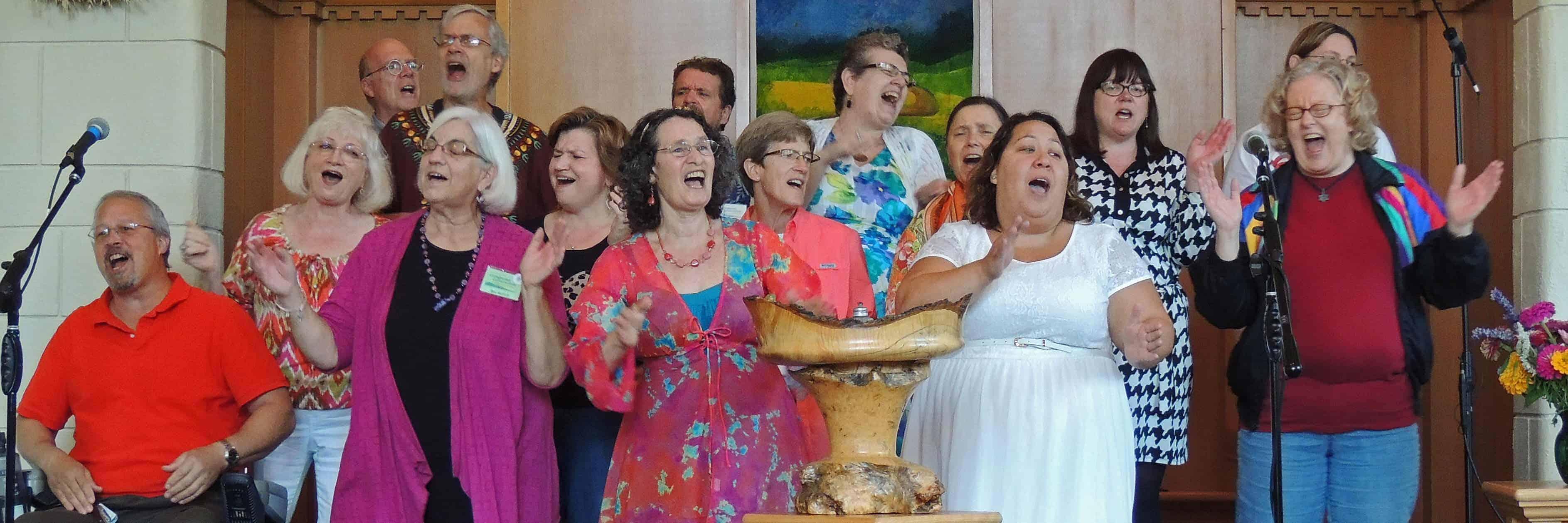 Photo of the UUCV choir singing enthusiastically