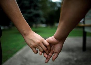 Isabela, an asylum seeker from El Salvador, holds her 17-year-old daughter Dayana's hand as they walk in a park, several days after they were reunited following their separation at the U.S.-Mexico, in Brentwood, Maryland, U.S.,, July 25, 2018. Picture taken July 25, 2018. REUTERS/Carlos Barria