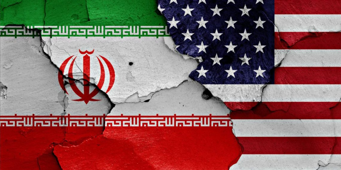 flags of Iran and USA painted on cracked wall