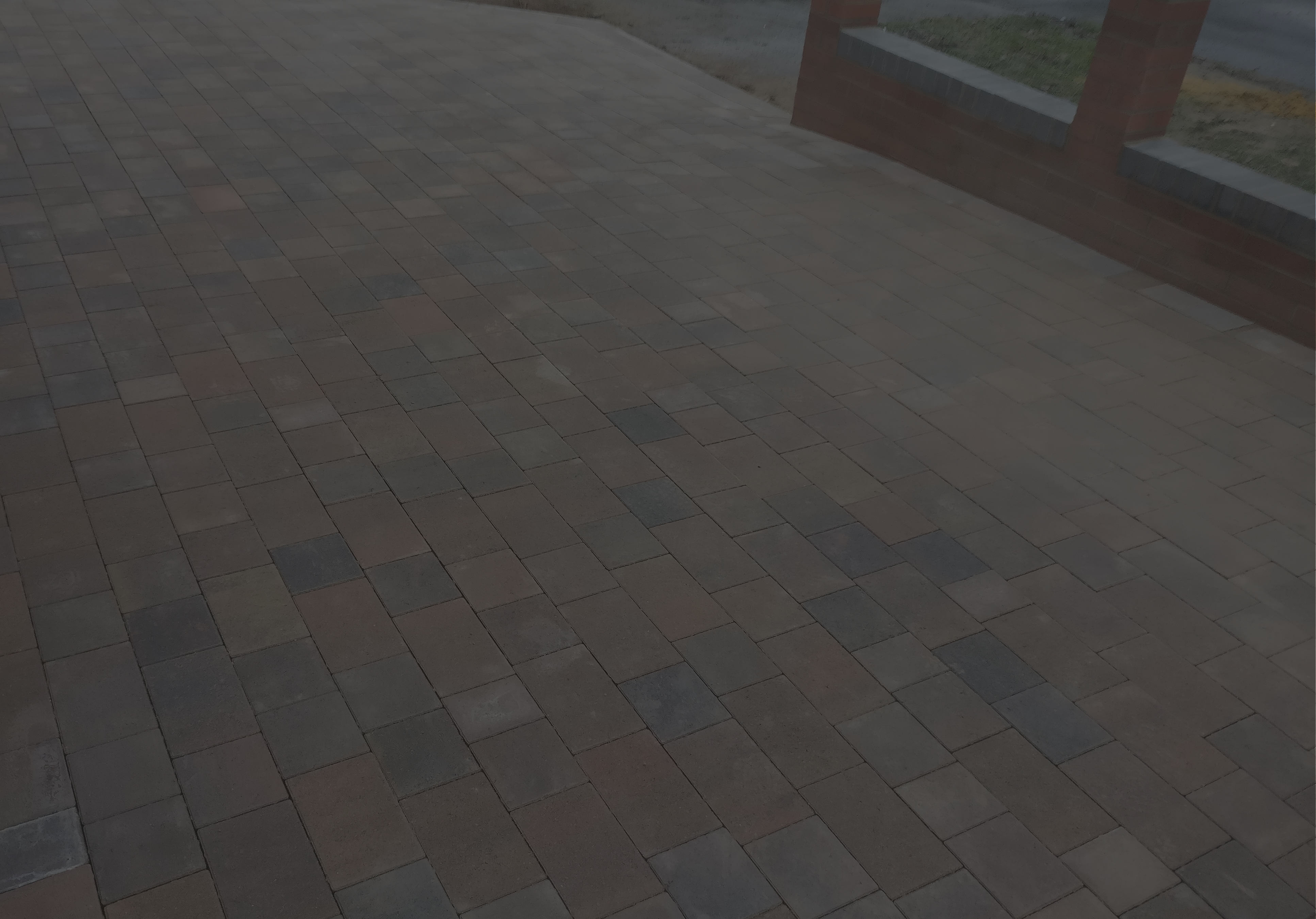 Block Paved Driveway with brick wall and rails.