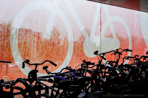 Rain drops on the sin for bicycle parking in Amsterdam.