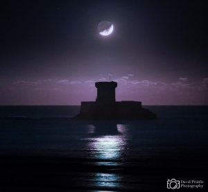 Moonset over La Rocco Tower, Jersey, Channel Islands.