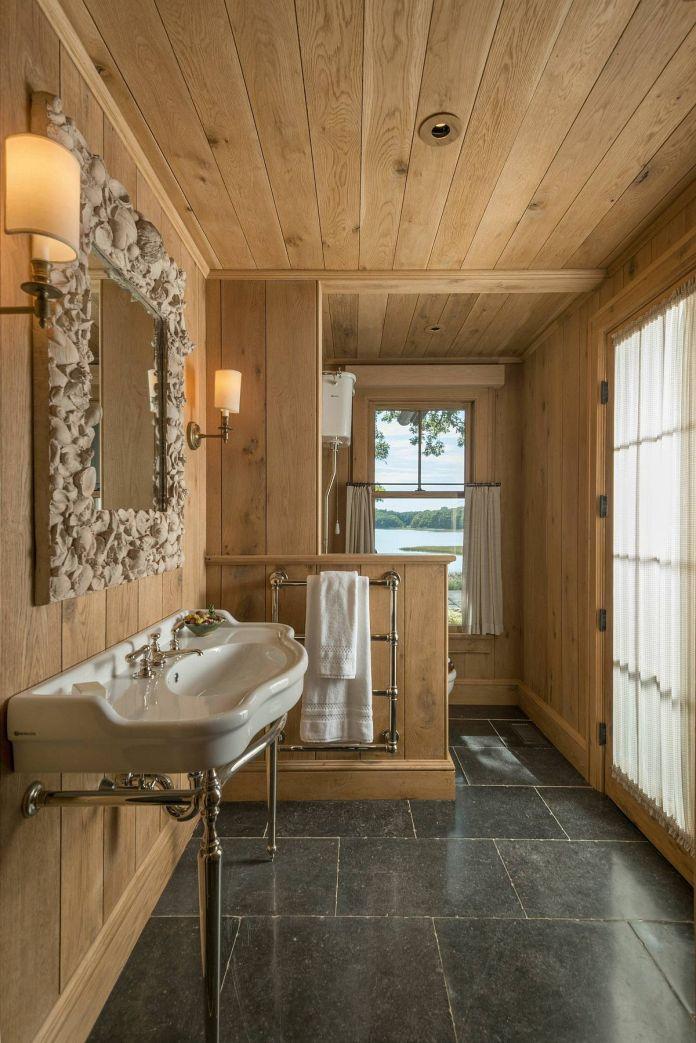 Rustic Bathroom With Unique Miiroor