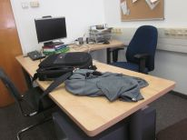 Gershon's spare desk, along with the monitor propped up on a book :)