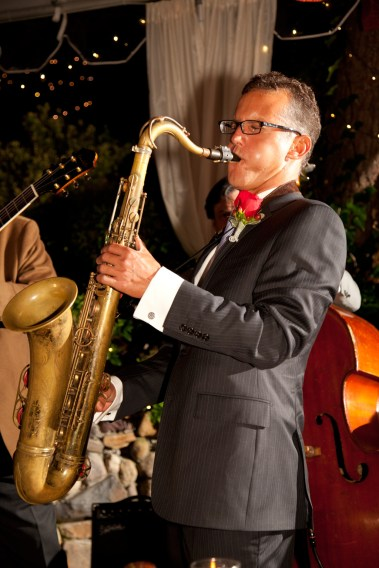 Photo of David Sills playing saxophone live on stage