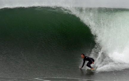 Photo of David Sills - Surfer-Saxophonist riding a wave at El-Porto