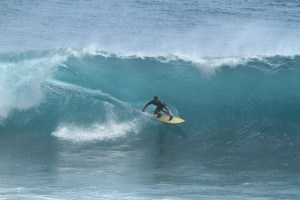 photo of David Sills surfing a large wave