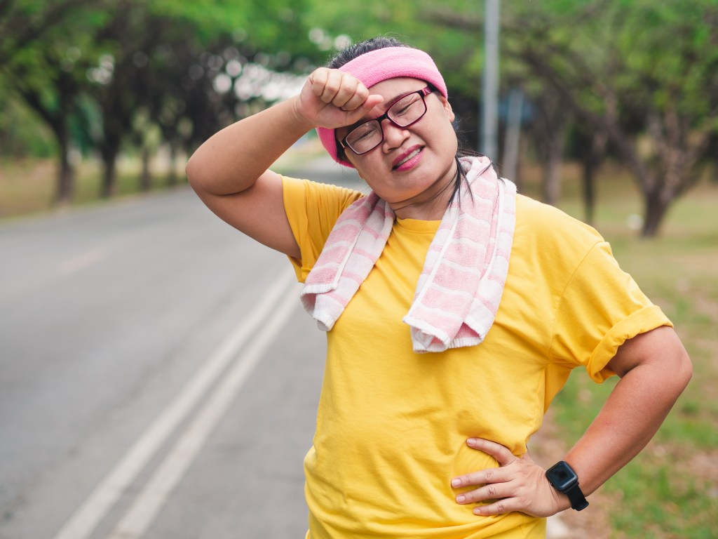 out of breath, overweight woman