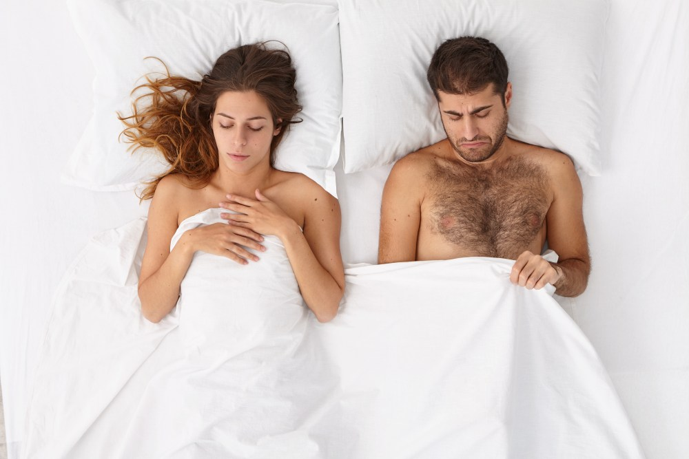 Unhappy couple in bed. Erectile dysfunction.