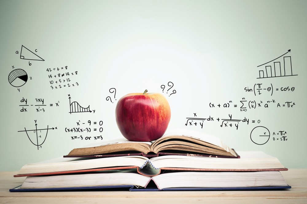 apple on open math books with equation behind