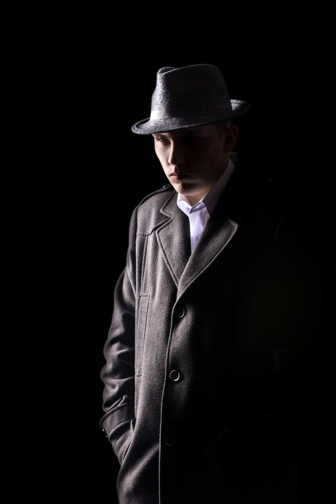 Shady man lurking in the shadows.