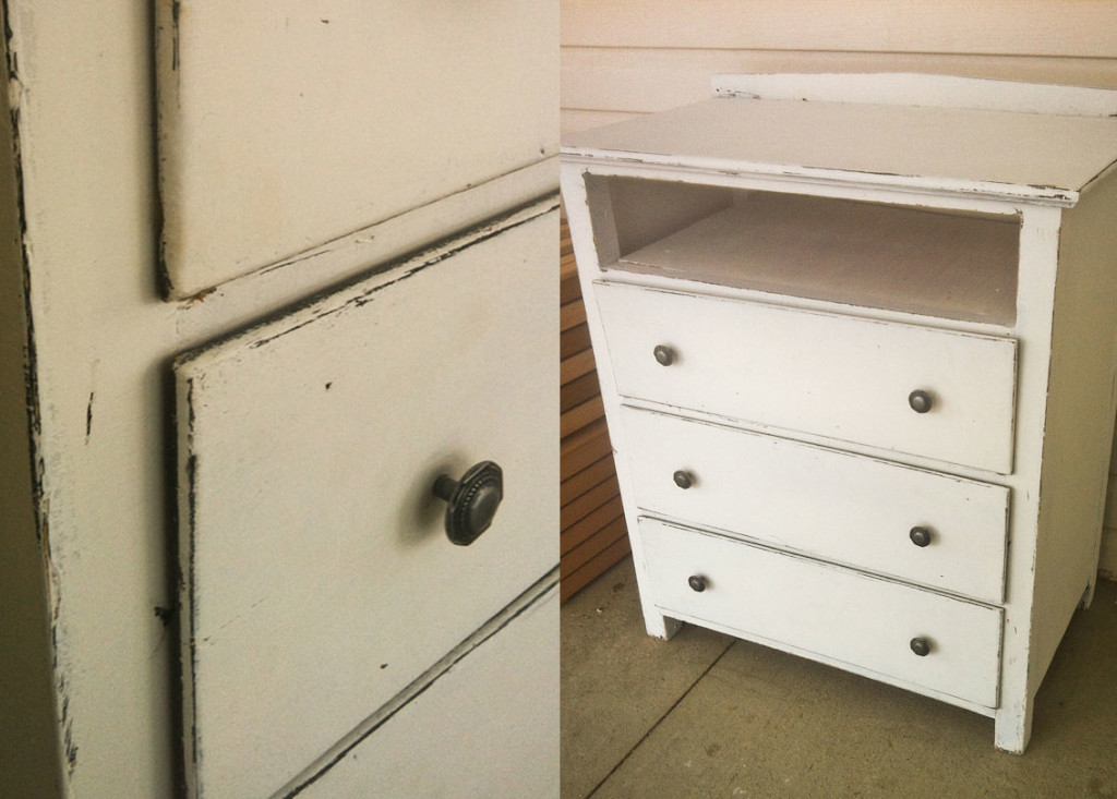 Old piece of crap black dresser on the side of the…