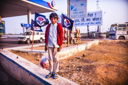"I've been on the road for a long time. People often ask me for how long I've been traveling, I use to say something like, a month, then 6 months, over a year... Now my answer is: ""It's been 33 years"". The little boy at the gas station. Rajasthan, India, 2014."