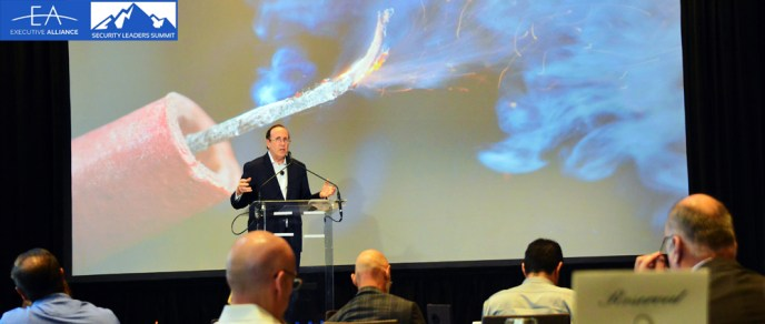 David X Martin addresses the crowd of cybersecurity professionals at the Secure Leaders conference in New York, 2019. Photo by Executive Alliance.