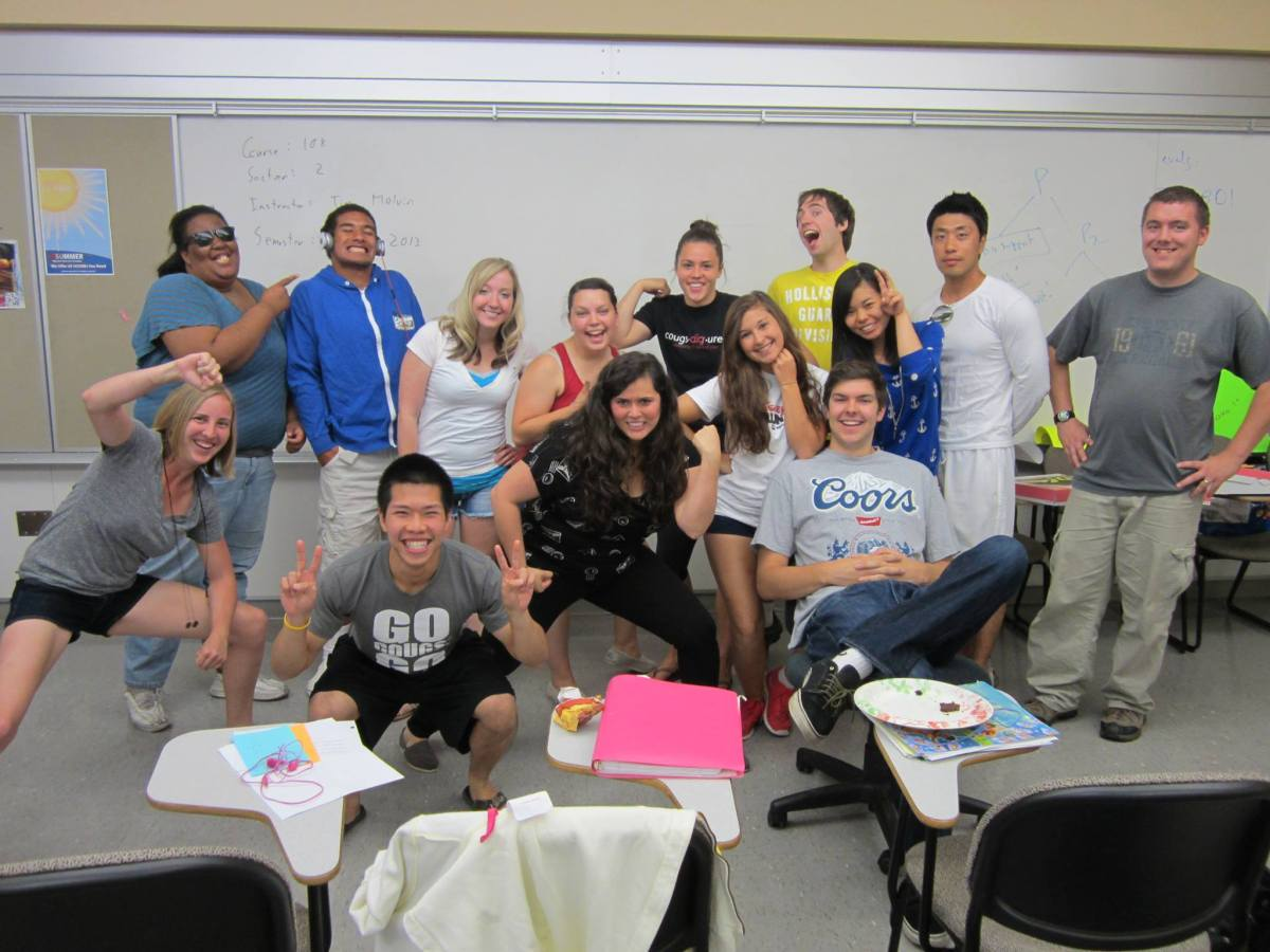 Photo of Davi with her students smiling and making goofy faces for the camera.