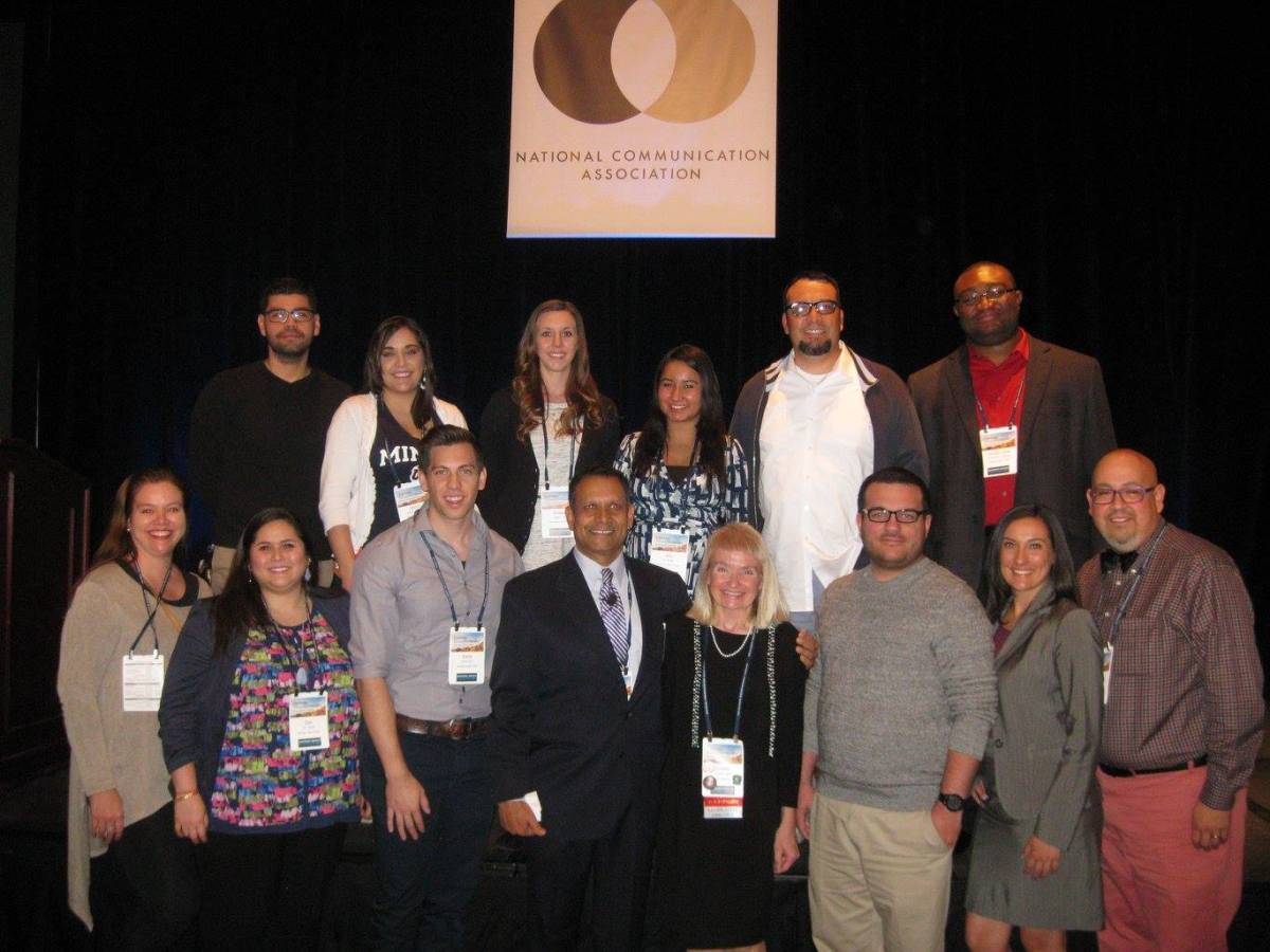 Photo of speakers at the National Communication Association smiling.