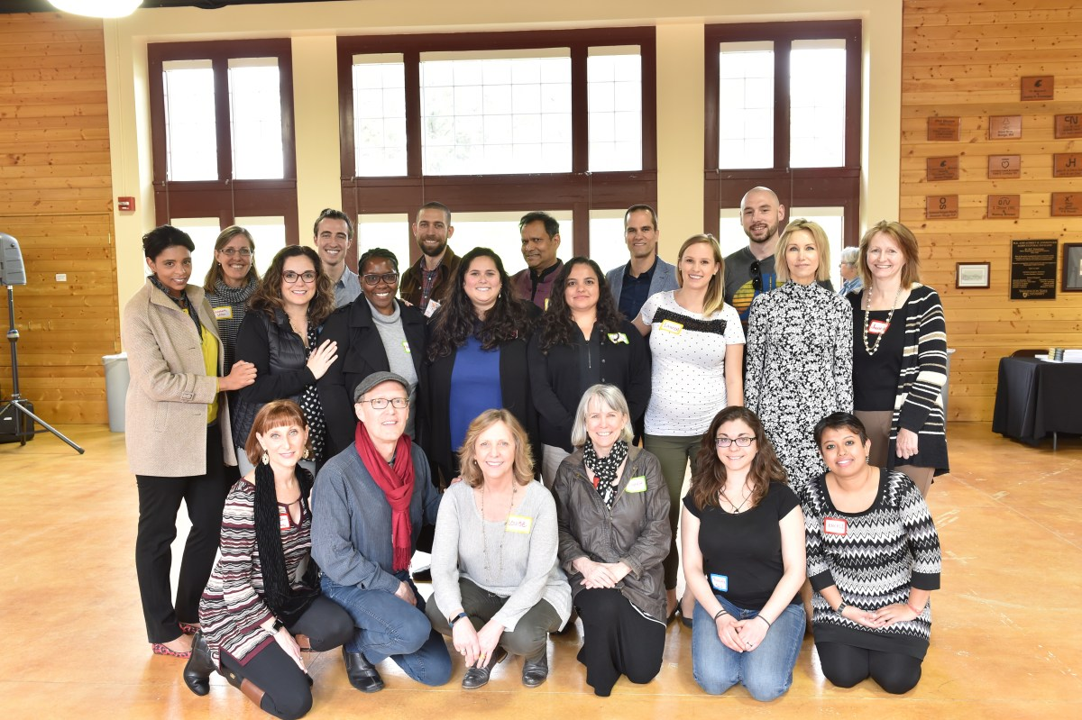 Photo of Liberating Structures WSU cohort from 2016. All are standing and sitting in rows and smiling at the camera.