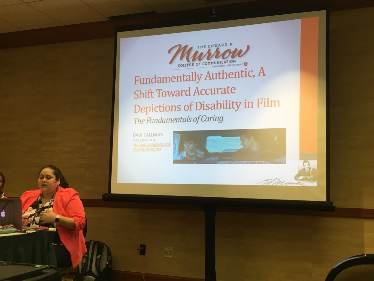 Photo of Davi presenting on depictions of disability in film.