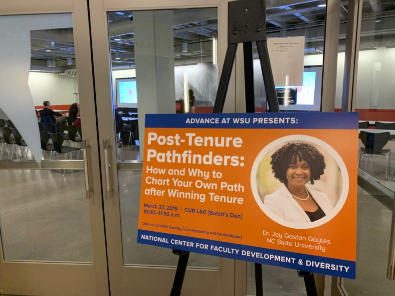 Photo of a large sign that reads, Post-Tenure Pathfinders: How and Why to Chart Your Own Path after Winning Tenure.