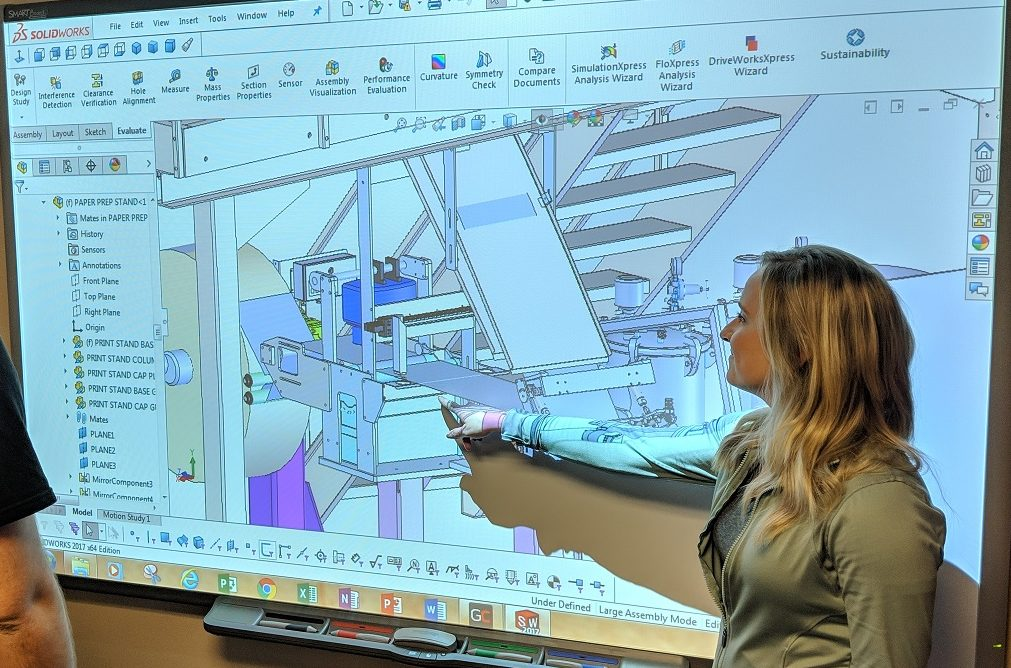 woman pointing at solidworks rendering