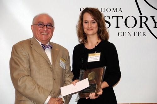 Tammy Parks receiving award from Dr. Felix Aquino