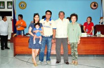 Reelected Governor Rodolfo del Rosario, with wife Milagros, and 1st District Congressman Anthony del Rosario, with wife Aina and their baby, after their PBOC proclamation. nobags