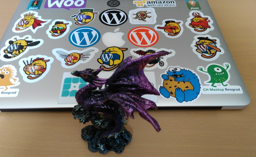 Dragon Figurine and a laptop