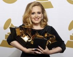 Adele Holding All her grammys