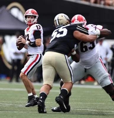 Georgia quarterback Stetson Bennett (13) during the Bulldogs' game with Vanderbilt in Vanderbilt Stadium in Nashville, Tenn., on Saturday, Sept. 25, 2021. (Photo by Tony Walsh)