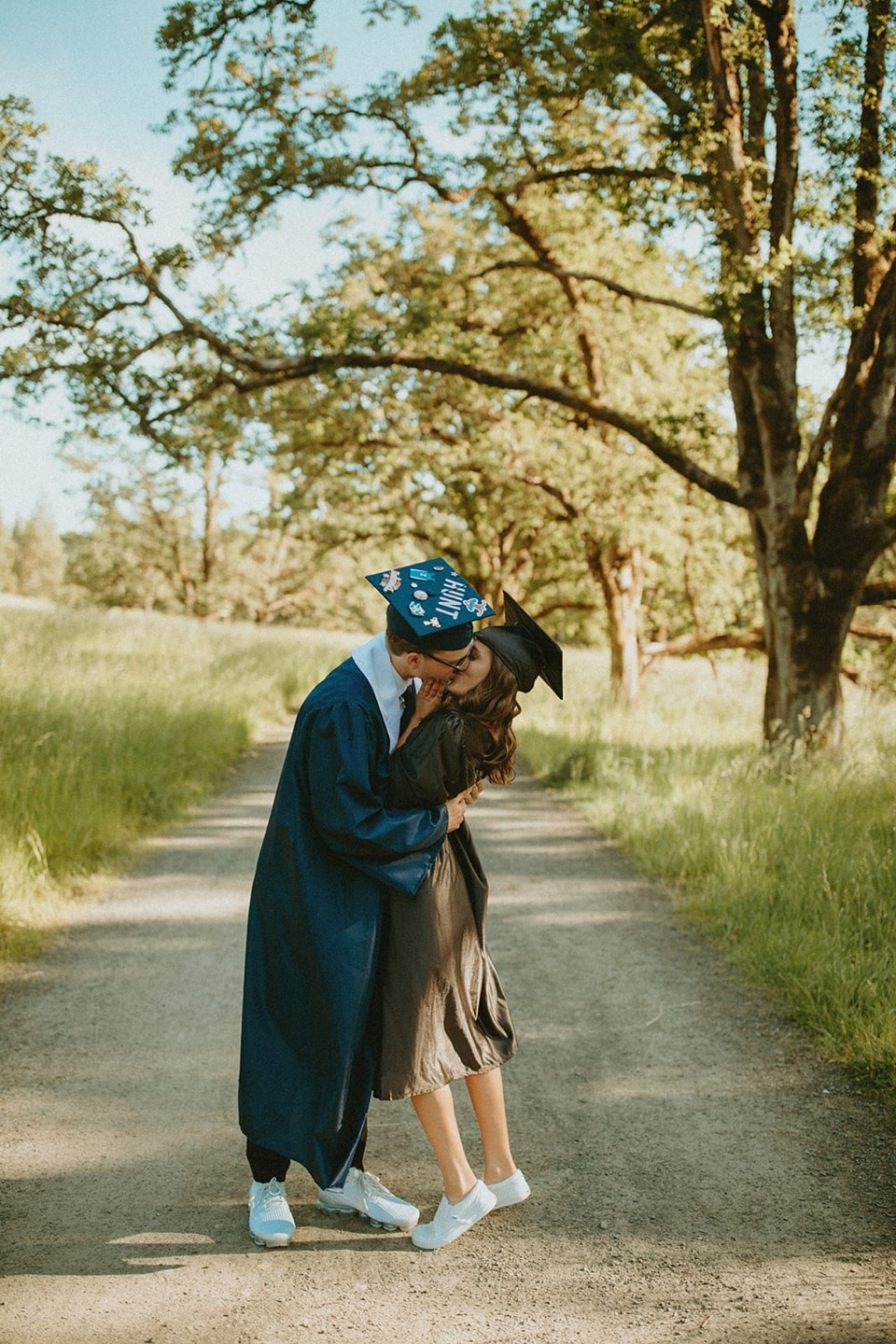 graduation picture of couple kissing