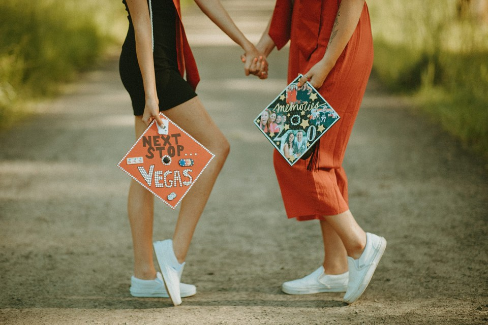friends holding their decorated caps