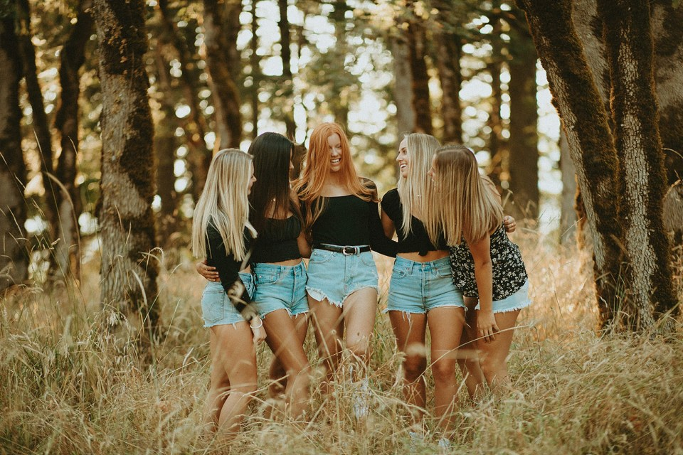 high school graduate with her friends