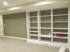 Media room, accent wall color, and built in shelving for Gregg's albums and turntable.