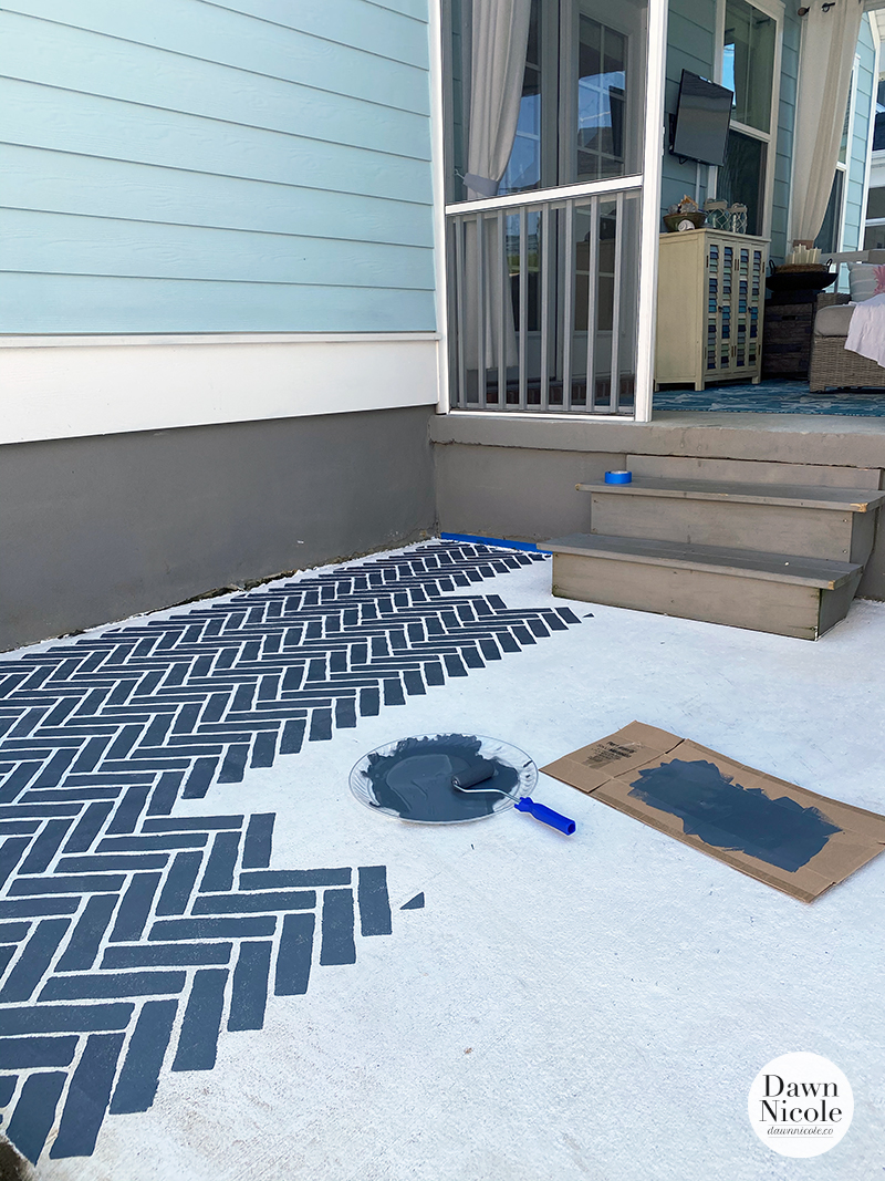 DIY Faux Brick Stenciled Concrete Patio. A stencil and paint completely transformed the look and feel of our dingy patio space!